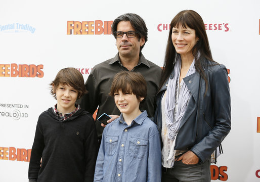 """Reel FX CEO Steve O'Brien poses with his family at world premiere of the animated film """"Free Birds"""" in Los Angeles"""