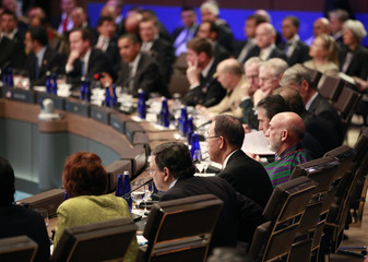 Afghan President Hamid Karzai listens to the heads of state meeting on Afghanistan at the NATO Summit in Chicago