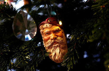 Traditional decorations are seen on a Christmas tree at a private home in Hanau