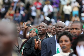 Faithful pray during a mass by Pope Francis in Kenya's capital Nairobi