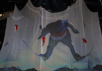 Performers ski and snowboard down a fabric mountain during the opening ceremony of the Vancouver 2010 Winter Olympics