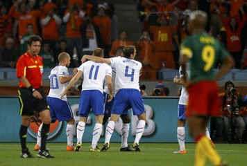 Netherlands' players celebrate after victory against Cameroon in a 2010 World Cup Group E soccer match at Green Point stadium in Cape Town