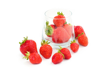 Organic fresh strawberries fruit in glass isolated on white background