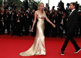 "Actors Jackson and Kruger pose on the red carpet as they arrive for the screening of the film ""Sleeping Beauty"" at the 64th Cannes Film Festival"
