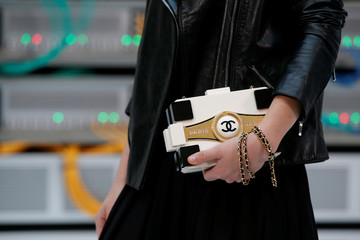 The Chanel logo is seen on a handbag before the Spring/Summer 2017 women's ready-to-wear collection for fashion house Chanel during Fashion Week in Paris