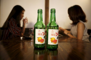 Bottles of fruit flavoured and low-alcohol soju are seen in this picture illustration at a pub in Seoul
