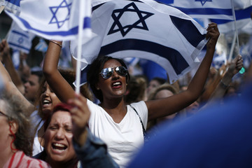 Pro-Israel supporters shout slogans during a rally at Times Square in New York, to show support for Israel's military offensive in the Gaza Strip