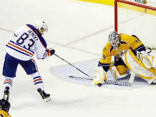 Edmonton Oilers right wing Ales Hemsky scores on Nashville Predators goalie Anders Lindback in Nashville