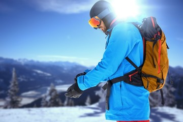 Composite image of side view of skier with backpack
