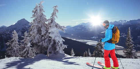 Composite image of skier with yellow backpack skiing