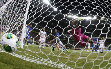 Japan's goalkeeper Kawashima fails to save a goal by Italy's De Rossi during their Confederations Cup Group A soccer match at the Arena Pernambuco in Recife