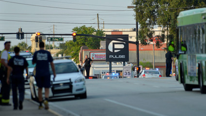 Police lock down Orange Avenue around Pulse nightclub, where people were killed by a gunman in a shooting rampage in Orlando
