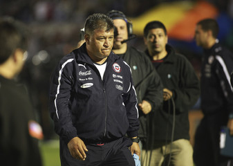 Chile's head coach Claudio Borghi leaves after being defeated 4-0 by Uruguay during their 2014 World Cup qualifying soccer match in Montevideo