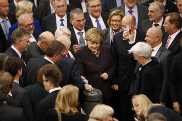 German Chancellor Merkel votes during a session of the German lower house of parliament, the Bundestag, in Berlin