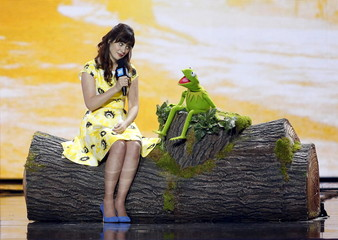 Actress Zooey Deschanel and Kermit the Frog talk on stage during WE Day California in Inglewood