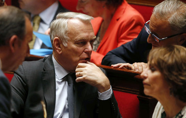 French Foreign Affairs Minister Jean-Marc Ayrault attends the questions to the government session at the National Assembly in Paris