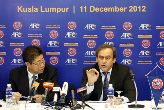 UEFA President Michel Platini (R) speaks as AFC Acting President Zhang Jilong listens after the signing of AFC-UEFA Memorandum of Understanding at AFC House in Kuala Lumpur