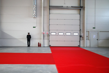 Firefighter stands next to fire-extinguishers at an empty production hall of the newly opened car factory of Great Wall Motor Co near the town of Lovech