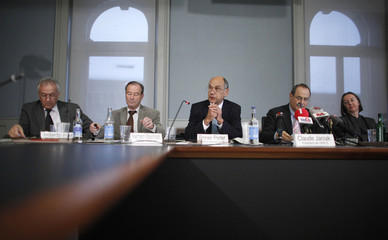 National Councilor and President of GPK Janiak and Councilor of State Briener talk to media during a news conference on Libya in Bern