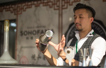 "Kit Cheung, Founder of Spirit of Spirit and Bar Consultant of Sohofama mixes ""Smoking Chamomile"" a Hong Kong inspired cocktail."