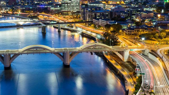 Brisbane City, Australia, Beautiful Panorama Aerial View of Kurilpa Bridge, William Jolly Bridge and Merivale Bridge over Brisbane River with GOMA and Brisbane Cityscape at Sunset Summer, Queensland