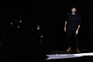 Italian designer Riccardo Tisci appears at the end of his Fall/Winter 2012-2013 women's ready-to-wear for Givenchy fashion show during Paris fashion week