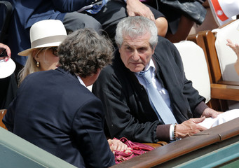French film director Claude Lelouch attends the women's singles final match between Maria Sharapova of Russia and Simona Halep of Romania at the French Open tennis tournament at the Roland Garros stadium in Paris