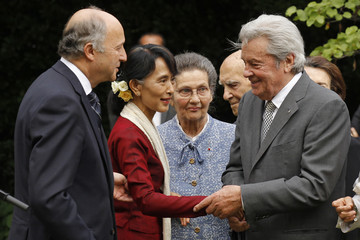 French actor Delon greets Myanmar pro-democracy leader Suu Kyi in gardens of the French Ministry of Foreign Affairs in Paris