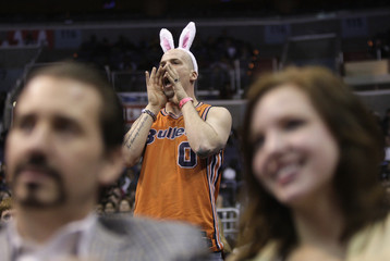 Washington Wizards fan Geisler, wearing bunny ears on Easter Sunday, cheers during NBA basketball game against Toronto Raptors in Washington