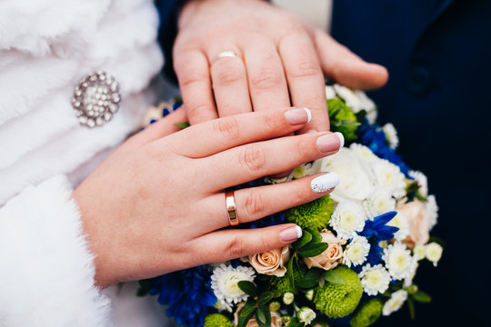 Loving newlyweds holding hands
