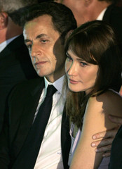 File photo of France's President Sarkozy and his wife Carla Bruni-Sarkozy who embrace in Rio de Janeiro