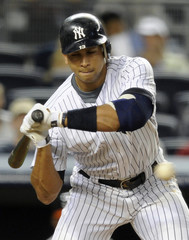 New York Yankees batter Alex Rodriguez takes a two-out 3-2 pitch from Baltimore Orioles starting pitcher Brian Matusz to draw a walk with the bases loaded and drive in a run in New York