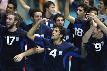 Argentina's players celebrate winning the gold medal after their volleyball game against Venezuela at the South American Games in Medellin