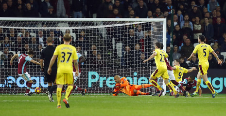 West Ham United's Aaron Cresswell clears off the line