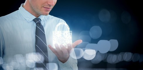 Composite image of businessman using futuristic mobile phone