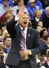 Kansas head coach Bill Self yells instructions during the Jayhawks' win over Kansas State in Kansas City