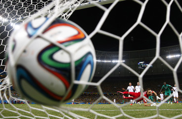 Greece's goalkeeper Glykos looks at the ball after failing to save a goal by Ivory Coast's Bony during their 2014 World Cup Group C soccer match at the Castelao arena in Fortaleza