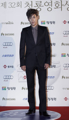South Korean actor and singer Choi poses for photographs before the Blue Dragon Film Awards in Seoul
