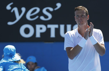 Tomas Berdych of Czech Republic celebrates after defeating Michael Russell of the U.S. in their men's singles match at the Australian Open tennis tournament in Melbourne