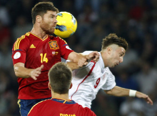 Georgia's David Targamadze goes for a header with Spain's Xabi Alonso during their 2014 World Cup qualifying soccer match at Boris Paichadze Stadium in Tbilisi