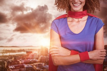Composite image of portrait of a woman pretending to be superher