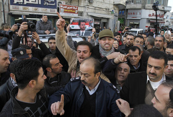 Palestinians gesture during a protest in support of Syria's President Bashar al-Assad in Ramallah
