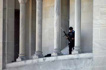 A sniper gets in position prior the Canonization Mass for Friar Junipero Serra celebrated by Pope Francis at the Basilica of the National Shrine of the Immaculate Conception in Washington