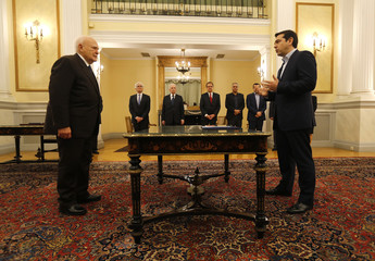 Tsipras is sworn in as Greece's first leftist prime minister in front of Greek President Papoulias in Athens
