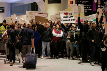 Demonstrators protesting U.S. Donald Trump's executive order travel ban greet arriving passengers at Logan Airport in Boston