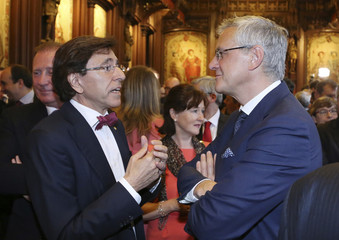 Belgium's PM Di Rupo talks to Flemish Minister-President Peeters during celebrations marking the Flemish Community Day at Brussels' town hall