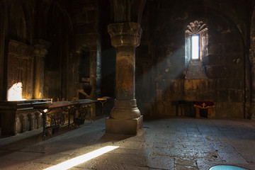 Fototapeta Interior of the old church in the monastery of Geghard, Armenia