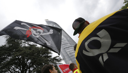 A Jolly Roger flag is pictured outside German mail carrier Deutsche Post headquarters during a demonstration of Verdi union members in Bonn