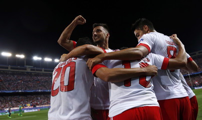 Benfica's Samaris celebrates his team's first goal against Atletico Madrid scored by Gaitan during their Champions League group C soccer match in Madrid