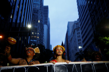 Indigenous people attend a demonstration against a constitutional amendment, known as PEC 55, that limits public spending, in Rio de Janeiro